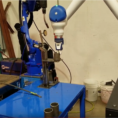 Cobot Places Parts at Welding Station